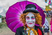 A group of Alice in Wonderland characters tour the site offering free hugs - The 2017 Glastonbury Festival, Worthy Farm. Glastonbury, 23 June 2017