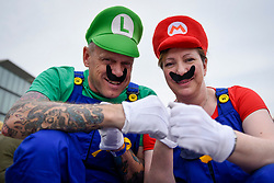 © Licensed to London News Pictures. 28/05/2017. London, UK. A couple dressed as Luigi and Mario at MCM Comic Con taking place at Excel in East London.  The three day event celebrates popular comic books, anime, games, television and movies.  Many attendees take the opportunity to dress as their favourite characters.    Photo credit : Stephen Chung/LNP