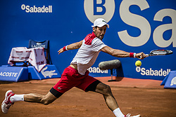April 25, 2018 - Barcelona, Catalonia, Spain - NOVAK DJOKOVIC (SRB) returns the ball to Martin Klizan (SVK) during Day 3 of the 'Barcelona Open Banc Sabadell' 2018. Klizan won 6:2, 1:6, 6:3 (Credit Image: © Matthias Oesterle via ZUMA Wire)