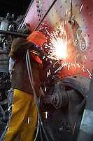 Welder welding stay bolts on the boiler of steamengine #45 of the California Wester Railroad