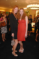 Left to right, OLIVIA INGE and LILY COLE at the launch party for the Mappin & Webb Regents Street branch at 132 Regent Street, London on 19th June 2007.<br />