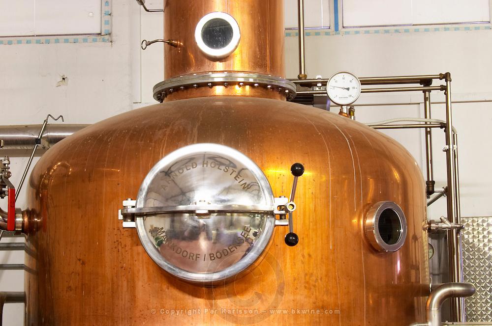 A distillation machine still in stainless steel and copper with narrow column. Marked Arnold Holstein Markdorg, Bodensee.. Valves and gauge Hercegovina Produkt winery, Citluk, near Mostar. Federation Bosne i Hercegovine. Bosnia Herzegovina, Europe.