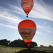 Pilots and crew launch Hot Air balloons around rural Michigan near Battle Creek during the World Hot Air Ballooning Championships. Battle Creek, Michigan, USA. 18th August 2012. Photo Tim Clayton