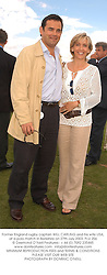WILL CARLING and his wife LISA at the Cartier International Polo at The Guards Polo Club, Windsor Great Park, Royal Berkshire on 27th July 2003.  For the 19th Year Cartier has sponsored this event attended by HM The Queen, Prince Philip and celebraries from the music world, stage and screen.  This year sees England play Mexico for the Coronation Cup - the main match, and The Prince of Wales team play Hurlingham for the Golden Jubilee Trophy.