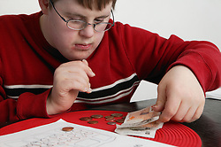 Boy counting out money,