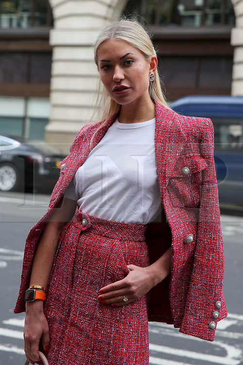 © Licensed to London News Pictures. 14/02/2020. London, UK. A fashion enthusiast arrives on day one of the London Fashion Week - Autumn/Winter collection fashion shows in The Strand. Photo credit: Dinendra Haria/LNP