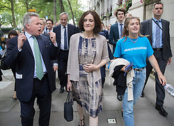 © Licensed to London News Pictures. 07/07/2016. London, UK. Tim Loughton MP and Northern Ireland Secretary Theresa Villiers march with other supporters of Conservative leadership candidate Andrea Leadsome  to Parliament. A second round of voting for the leadership of Conservative party is taking place today.  Photo credit: Peter Macdiarmid/LNP