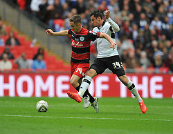 Derby County's George Thorne tackles Queen Park Rangers' Kevin Doyle  - Photo mandatory by-line: Alex James/JMP - Tel: Mobile: 07966 386802 24/04/2014 - SPORT - FOOTBALL - wembley - London -  Derby County V Queens Park Rangers - Play off final