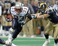 New England Patriots running back Kevin Faulk (33) rushes past St. Louis Rams safety Adam Archuleta for a nine yard gain, during the second quarter of the Patriots 40-22 win in St. Louis, Missouri, November 7, 2004.