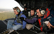 U.S. Senators Patty Murray, left, and Maria Cantwell, center, along with Carlos Castillo, assistant administer for disaster assistance of FEMA on the back ramp of a Chinook helicopter during an air tour of flooding of Lewis and Grays Harbor counties, WA. (AP Photo/John Froschauer)