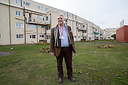 Norman Walsh of Firefly energy, provider of the Cosy Homes Scheme in front of one of the low-rise tower blocks in Blackpool to have external wall insulation fitted. The 'Cosy Homes in Lancashire' (CHiL) scheme is a countywide energy efficiency and affordable warmth initiative. It offers an accessible and straightforward means of accessing grants from energy companies and other sources to fund new heating measures, insulation and renewable technologies in domestic properties.  ALL image publications MUST include the credit © Andrew Aitchison / Ashden
