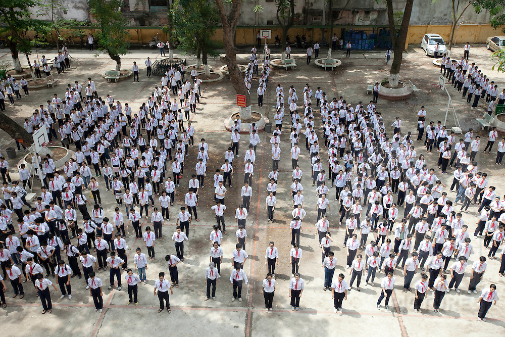 Vietnamese kids line up in a courtyart for their daily workout routine, Hanoi, Vietnam, Southeast Asia