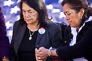"""07 DECEMBER 2010 - PHOENIX, AZ:  DOLORES HUERTA, left, and ROSA MARIA SOTO pray during a fast in support of the DREAM Act at the offices of US Sen. John McCain in Phoenix, Tuesday. Huerta, who started working in the civil rights movement in the 1960's, threw her support behind students fasting on behalf of the DREAM Act in front of Sen. John McCain's office Tuesday. The student picked McCain's office because he used to support the DREAM Act. They hope that the US Senate will pass the DREAM Act during its """"lame duck"""" session. The Senate debated and defeated similar legislation just before the November general election.    PHOTO BY JACK KURTZ"""