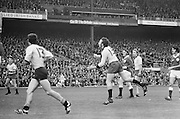 Dublin player just after hitting the ball forward during the All Ireland Senior Gaelic Football Championship Final Dublin V Galway at Croke Park on the 22nd September 1974. Dublin 0-14 Galway 1-06.
