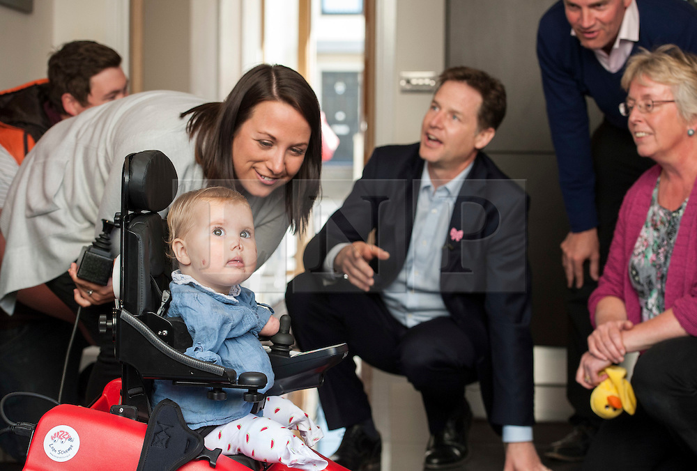 © Licensed to London News Pictures.  28/04/2015. Bath UK.  Picture of Nick Clegg with baby Harmonie-Rose Allen aged 17 months who lost all 4 of her limbs due to meningitis. Deputy Prime Minister Nick Clegg visits the Bath Riverside housing development with Liberal Democrat candidate Steve Bradley and outgoing MP Don Foster.  On the day new GDP figures are published, Nick Clegg's visit highlights the Lib Dem record in Government of stimulating sustainable economic development that delivered jobs and apprenticeships. Photo credit : Simon Chapman/LNP
