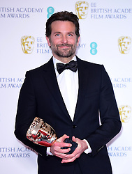 Bradley Cooper with his Best Original Music Bafta for A Star is Born in the press room at the 72nd British Academy Film Awards held at the Royal Albert Hall, Kensington Gore, Kensington, London.