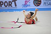 Hayakawa Sakura during qualifying at ribbon in Pesaro World Cup 27 April 2013. Sakura is a Japan rhythmic gymnastics athlete born March 17, 1997 in Osaka, Japan. She appeared in Senior competitions in the 2013 season.