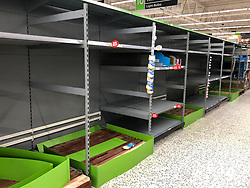 © Licensed to London News Pictures. 13/03/2020. Leeds UK. ASDA LEEDS. Empty Toilet Roll shelves at ASDA in the Killingbeck area of Leeds this morning as people continue to panic buy in fear of quarantine measures and shortages as the current Coronavirus ( COVID-19 ) spread starts to impact more people. Photo credit: Andrew McCaren/LNP