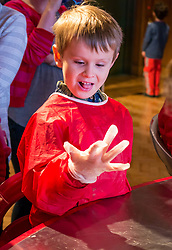City Arts Centre, Edinburgh, Scotland, United Kingdom, 9 April 2019. Edinburgh Science Festival:  Alex, age 6 years, has fun learning about blood with a sheep heart at the Blood Bar drop in event with Science Communicator Hannah at the Science Festival. <br /> <br /> Sally Anderson | EdinburghElitemedia.co.uk