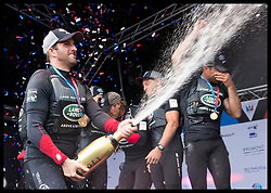 July 24, 2016 - Portsmouth, United Kingdom - Image licensed to i-Images Picture Agency. 24/07/2016. Portsmouth, United Kingdom. Sir Ben Aisle sprays his team with champagne after they won the weekends racing at the  the America's Cup World Series in Portsmouth, United Kingdom.  Picture by Stephen Lock / i-Images (Credit Image: © Stephen Lock/i-Images via ZUMA Wire)