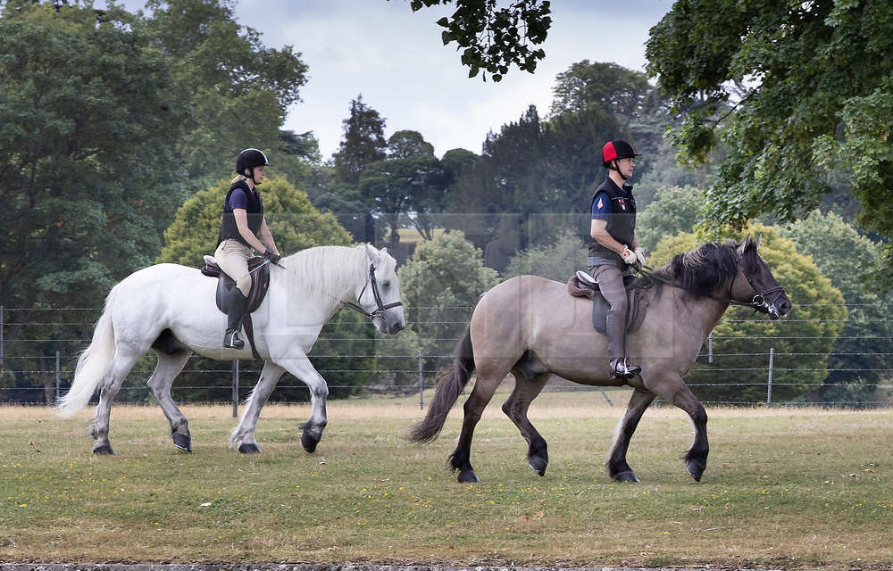 IMAGE FROM 25th JULY 2020. © Licensed to London News Pictures. 25/07/2020. Windsor, UK. Prince Edward, Earl of Wessex, is seen horse riding with his daughter Lady Louise Windsor, next to the River Thames near Windsor Castle.  Photo credit: Peter Macdiarmid/LNP