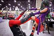 27 MAY 2011 - PHOENIX, AZ: DAVID STARRY, left, as Darth Maul, battles ALLISON BANDEL as Circa Napier, her own creation, which she said was the Joker's daughter from the Batman series, at Phoenix Comicon Friday. Phoenix Comicon opened Thursday and featured a Zombie Walk through downtown Phoenix Friday night. Hundreds of people participated in the Zombie Walk, both as Zombies and as Zombie hunters. This year's Comicon includes appearances by Leonard Nimoy (Star Trek), Adam Baldwin (Firefly and Chuck), Stan Lee (Marvel Comics), Nicholas Brendon (Buffy the Vampire Slayer) and others. Activities include costuming workshops, role playing games and a Geek Prom.     Photo by Jack Kurtz