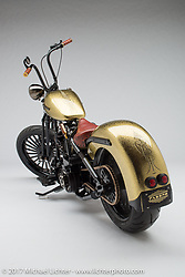 """""""Type 57X"""", a gold and black shovelhead chopper built by Terence Musto of Fabbro Industries in Voorheesville, NY. Photographed by Michael Lichter in Sturgis, SD on August 3 2017. ©2017 Michael Lichter."""