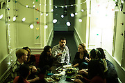 SAN FRANCISCO, CA – JANUARY 13, 2016: A group of Minerva college students enjoy dinner together in the San Francisco residence hall.<br /> <br /> Minerva is a unique 21st century university built on a global four-year education model. It is deliberately designed to enhance intellectual growth and prepare students for success in today's rapidly changing global context. Founded in 2014, the university targets the developing world's rising middle class who seek an elite American education. With a 2.8% acceptance rate among the founding class, Minerva is the most selective undergraduate program in U.S. history.