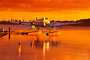 Float plane on lake at sunrise<br /> Ear Falls<br /> Ontario<br /> Canada