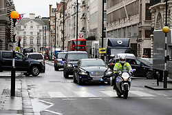 **VIDEO AVAILABLE HERE: http://tinyurl.com/h4org96 CALL TO AGREE FEES** <br /> © Licensed to London News Pictures. 09/01/2017. London, UK. Still images taken form video showing Prime Minister Theresa May's convoy making it's way along Pall Mall before taking a wrong turn in to a dead end and having to perform a u-turn. The error was made turning down Carlton House Terrace, while travelling to make a speech on mental health care. Photo credit: Peter Macdiarmid/LNP
