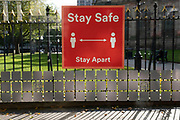 With new local coronavirus lockdown measures now in place and Birmingham currently set at 'Tier 2' or 'high', people pass a bus shelter 'stay safe' sign in the city centre on 14th October 2020 in Birmingham, United Kingdom. This is the first day of the new three tier system in the UK which has levels: 'medium', which includes the rule of six, 'high', which will cover most areas under current restrictions; and 'very high' for those areas with particularly high case numbers. Meanwhile there have been calls by politicians for a 'circuit breaker' complete lockdown to be announced to help the growing spread of the Covid-19 virus.