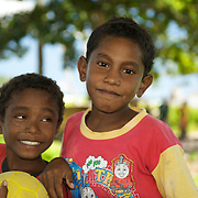 Portrait of two papuan boys ready for a football game.