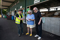 Public Works Director Meghan Theriault explains the recycling options to Suzanne Slatz and Allen Everett at the Gilford Solid Waste Center on Wednesday.  (Karen Bobotas/for the Laconia Daily Sun)