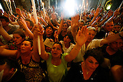 Gitans praying to Saint Sara and the Saintes Maries in the church mass 'La descent de la Chasse' during the Gypsy pilgrimmage at Saintes Maries de la Mer<br /><br />Europe, France, Camargue, Saintes Maries de la Mer, Gypsy Pilgrimmage 'Pelerinage des Gitans aux Saintes Maries de la Mer'. Gypsies from all over the world come to celebrate their patron Saint Sara who is carried by them from the church to the sea-shore. May 24th and 25th every year