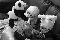 Lotus and Forest Hoben learn about pandas as part of their homeschooling during the coronavirus pandemic in the Hudson Valley, New York. Forest and Lotus Hoben, ages 10 and 6, were adopted from China and have albinism, a rare group of genetic disorders that cause the skin, hair, or eyes to have little or no color. Albinism is also associated with vision problems. According to the National Organization for Albinism and Hypopigmentation, about 1 in 18,000 to 20,000 people in the United States have a form of albinism.