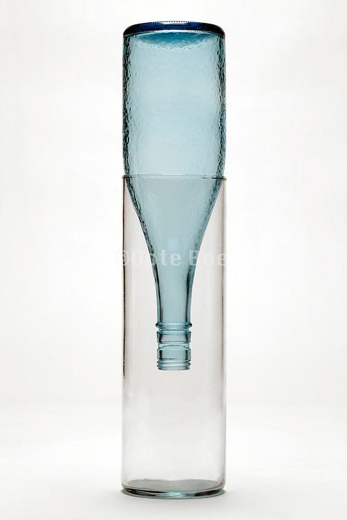 empty bottle upside down in glass