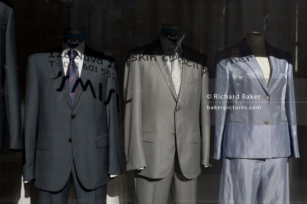 Shiny suits on display in a clothes shop window on Dunajska Cesta (street) in the Slovenian capital, Ljubljana, on 27th June 2018, in Ljubljana, Slovenia.
