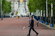 A man wearing face protective mask is seen walking through Pall Mall Street, facing Kingdom's Buckingham Palace in London, Britain, on Sunday, May 3, 2020. Britons are now in their sixth week of lockdown due to the Coronavirus pandemic. Countries around the world are taking increased measures to stem the widespread of the SARS-CoV-2 coronavirus which causes the Covid-19 disease. (Photo/ Vudi Xhymshiti)