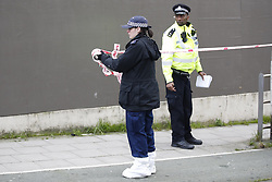© Licensed to London News Pictures. 20/01/2020. London, UK. Police cordon off an area where blood spots were found on the pavement near a murder scene in Seven Kings in east London as an investigation is launched into the deaths of three men all of whom had suffered apparent stab injuries. Photo credit: Peter Macdiarmid/LNP