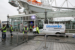 © Licensed to London News Pictures. 07/01/2019. London, UK. Workmen at the entrance of the Coca Cola London Eye which is closed for its annual maintenance refurbishment. The popular tourist attraction is 135m/443ft high and there are 32 capsules attached to the wheel will re-open on 23rd January 2019. The London Eye is Europe's tallest cantilevered observation wheel and over 3.75 million visitors visits the London Eye annually. Photo credit: Dinendra Haria/LNP