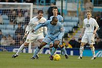 Fotball<br /> England 2004/2005<br /> Foto: SBI/Digitalsport<br /> NORWAY ONLY<br /> <br /> Coca Cola Championship<br /> 03/01/2005<br /> <br /> Coventry City v Leeds United <br /> <br /> Coventrys Dele Adebola tries to find a way past leeds Sean Gregan