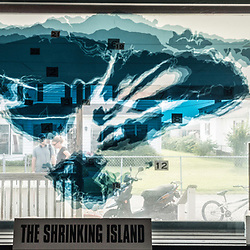 August 4, 2017 - Tangier Island, VA - A map painted onto a window of the Tangier History Museum shows the erosion of the island over the past 250 years.  Tangier Island is rapidly losing its landmass every year. A seawall on the western part of the island has prevented erosion to that side and the island's 700 remaining residents are seeking aid to prevent further erosion of the island where for several hundred years Chesapeake bay watermen have made their living reaping crab and oyster harvests from the bay. <br /> Photo by Susana Raab/Institute