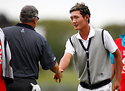 Danny Lee (NZL) shakes hands with playing partner Peter O'Malley (NSW) at the end of his round. Round One, HSBC New Zealand PGA Golf Championship. Clearwater Golf Resort, Christchurch, New Zealand. Thursday 5th March 2009. Copyright Photo: www.photosport.co.nz