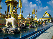 """13 DECEMBER 2017 - BANGKOK, THAILAND:  Statuary of mythical beasts including a """"Kraisonrajasiha,"""" a Lion-King with tufts of hair on its feet on the east side of the Royal Crematorium on Sanam Luang in Bangkok. The crematorium was used for the funeral of Bhumibol Adulyadej, the Late King of Thailand. He was cremated on 26 October 2017. The crematorium is open to visitors until 31 December 2017. It will be torn down early in 2018. More than 3 million people have visited the crematorium since it opened to the public after the cremation of the King.    PHOTO BY JACK KURTZ"""