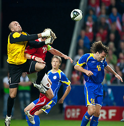 07.09.2010, Red Bull Arena, Salzburg, AUT, UEFA 2012 Qualifier, Austria vs Kazakhstan, im Bild Andrei Sidelnikov (FK Aktobe, Kazakhstan, #1) boxt den Ball vor Marc Janko (FC Twente, Austria, #21)we g, Alexey Popov (FC Amkar Perm, Kazakhstan, #16), EXPA Pictures © 2010, PhotoCredit: EXPA/ J. Feichter / SPORTIDA PHOTO AGENCY