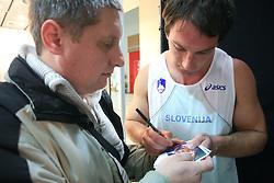 Olympic winner Primoz Kozmus and a fan at fashion show of new jerseys of Slovenian Athletic National Team, on October 28, 2008, in Mercator center Siska, Ljubljana, Slovenia. (Photo by Vid Ponikvar / Sportal Images).