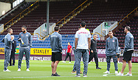 Olympiakos players inspect the pitch at Turf Moor<br /> <br /> Photographer Alex Dodd/CameraSport<br /> <br /> UEFA Europa League - UEFA Europa League Qualifying Second Leg 2 - Burnley v Olympiakos - Thursday August 30th 2018 - Turf Moor - Burnley<br />  <br /> World Copyright © 2018 CameraSport. All rights reserved. 43 Linden Ave. Countesthorpe. Leicester. England. LE8 5PG - Tel: +44 (0) 116 277 4147 - admin@camerasport.com - www.camerasport.com