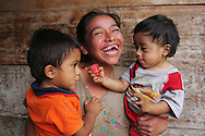 ety Francisca Ramirez, 22,   holding her sons José Luis, 2, left, and Julio 1 in her home in Coatepeque, Guatemala. Gente Unida members visit the homes of other HIV+  patients such as Lety to answer questions, check up on their health, distribute food supplies, and help ensure that they are taking their anti-retrovirals. Ramirez has been having a hard time getting her oldest son Adolfo Noel (not shown)to take his anti-retrovirals, a Gente Unida employee suggests that she train him with m&ms. Ramirez's other children have all tested negative. The disease is heavily stigmatized in Guatemala where about  one percent of the population is HIV + and there are 10,000 known cases of people living with AIDS. All the members of Gente Unida are HIV+ and share their status openly in order to help others feel like they are not alone. Sara A. Fajardo/CRS