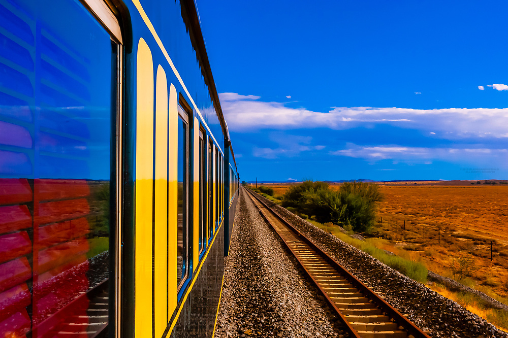 """Rovos Rail train  """"Pride of Africa"""" crosses the Great Karoo Desert on it's journey between Pretoria and Cape Town, South Africa."""