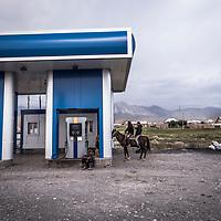 Petrol station scene, Sary Mogol village Kyrgyzstan.